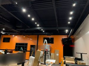 Black Track Lighting Suspended from Black Architectural Ceiling